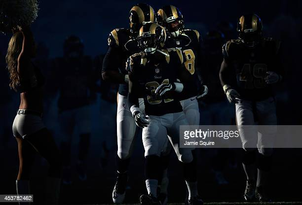 Maurice Alexander and the St Louis Rams run onto the field prior to the preseason game against the Green Bay Packers at Edward Jones Dome on August...