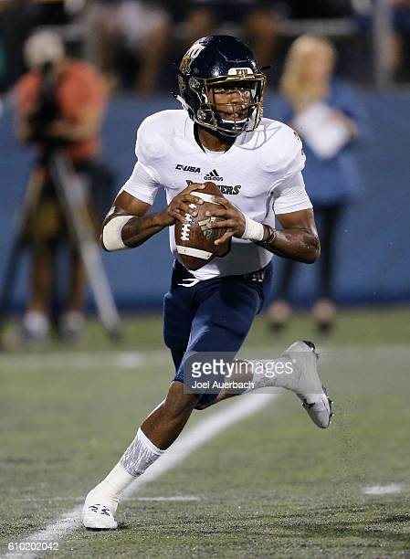 Maurice Alexander of the Florida International Golden Panthers scrambles out of th pocket with the ball against the Central Florida Knights on...