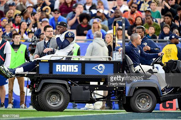 Maurice Alexander of the Los Angeles Rams leaves the field after a collision with Nick Williams of the Atlanta Falcons at Los Angeles Memorial...
