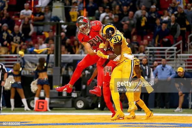 Maurice Alexander of the St Louis Rams breaks up a pass intended for Cameron Brate of the Tampa Bay Buccaneers in the fourth quarter at the Edward...