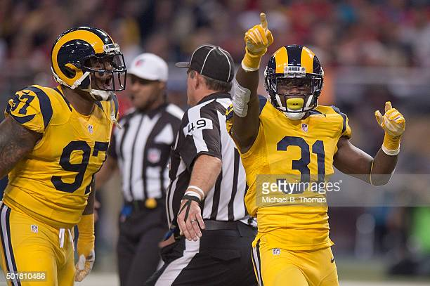 Maurice Alexander of the St Louis Rams celebrates after Eugene Sims sacked Jameis Winston of the Tampa Bay Buccaneers in the first quarter at the...
