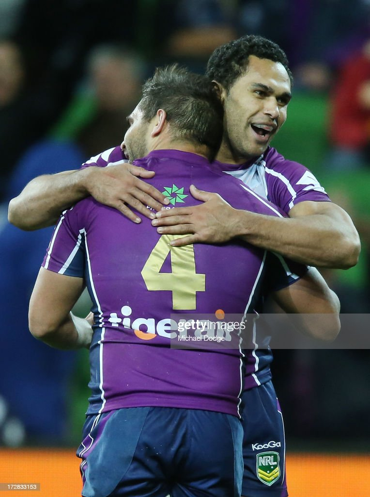 Maurice Blair (L) of the Storm celebrates a try with Justin O'Neill during the round 17 NRL match between the Melbourne Storm and the Brisbane Broncos at AAMI Park on July 5, 2013 in Melbourne, Australia.