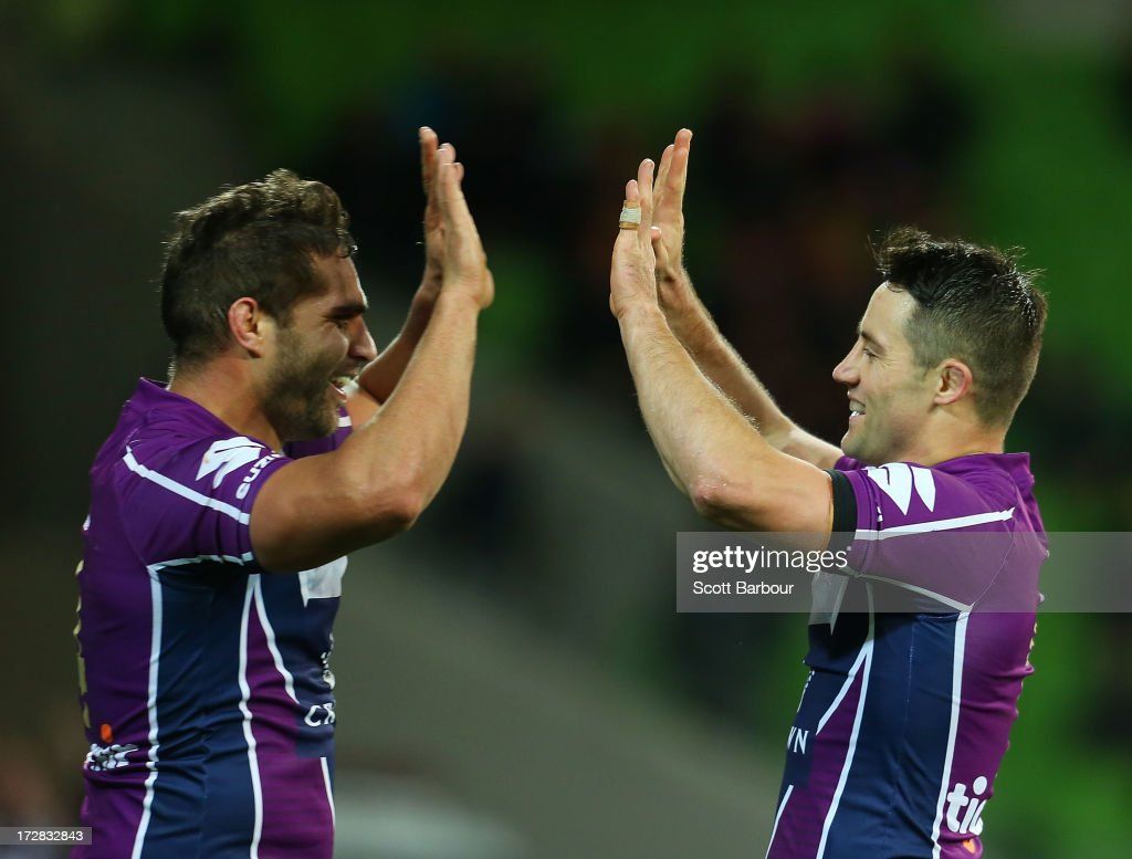 Maurice Blair (L) of the Storm celebrates with <a gi-track='captionPersonalityLinkClicked' href=/galleries/search?phrase=Cooper+Cronk&family=editorial&specificpeople=234620 ng-click='$event.stopPropagation()'>Cooper Cronk</a> after scoring a try during the round 17 NRL match between the Melbourne Storm and the Brisbane Broncos at AAMI Park on July 5, 2013 in Melbourne, Australia.