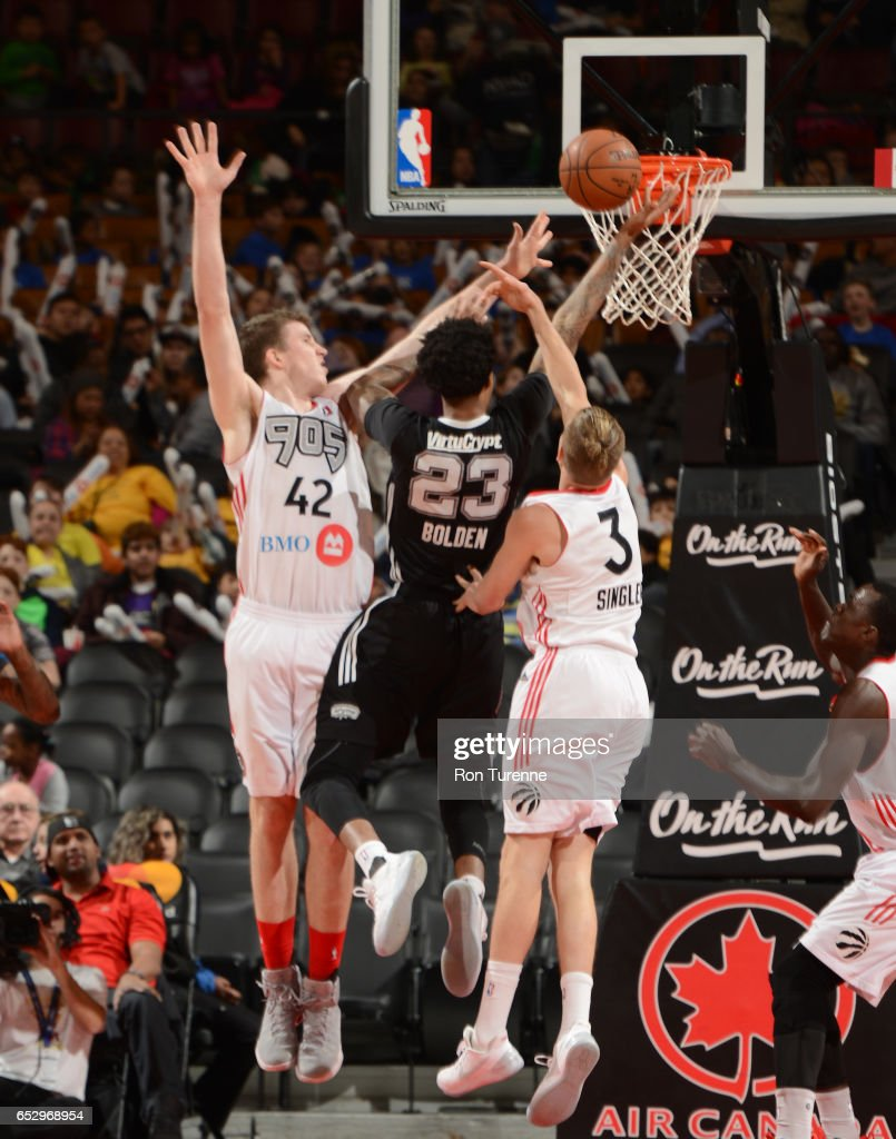 Maurice Bolden #23 of the Austin Spurs lays the ball to the basket over Jakob Poeltl #42 and E.J Singler #3 of the Raptors 905 at the Air Canada Centre on March 13, 2017 in Toronto, Ontario, Canada.