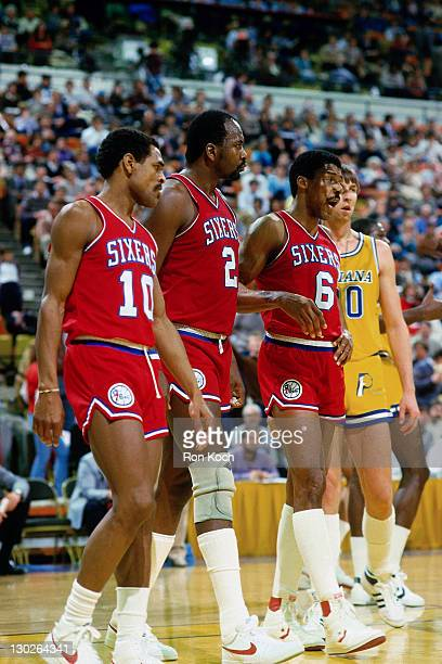 Maurice Cheeks Moses Malone and Julius Erving walk against the Indiana Pacers during a game played circa NOTE TO USER User expressly acknowledges and...