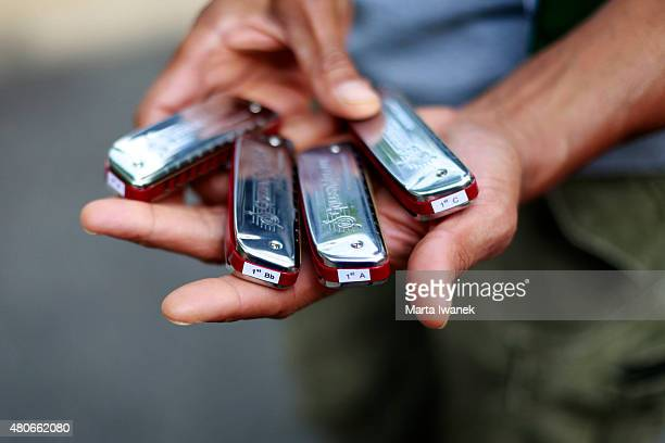 JULY 3 Maurice Dean Wint shows the different keys he has for harmonica as the cast of The Postman rehearse on Palmerston Boulevard in Toronto July 3...