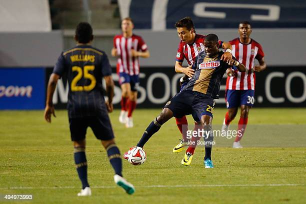Maurice Edu of Philadelphia Union and Erick Torres of Chivas USA fight for the ball in the second half at StubHub Center on May 31 2014 in Los...
