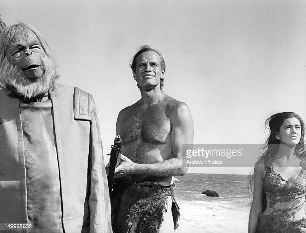 Maurice Evans Charlton Heston and Linda Harrison looking up from the beach in a scene from the film 'Planet Of The Apes' 1968