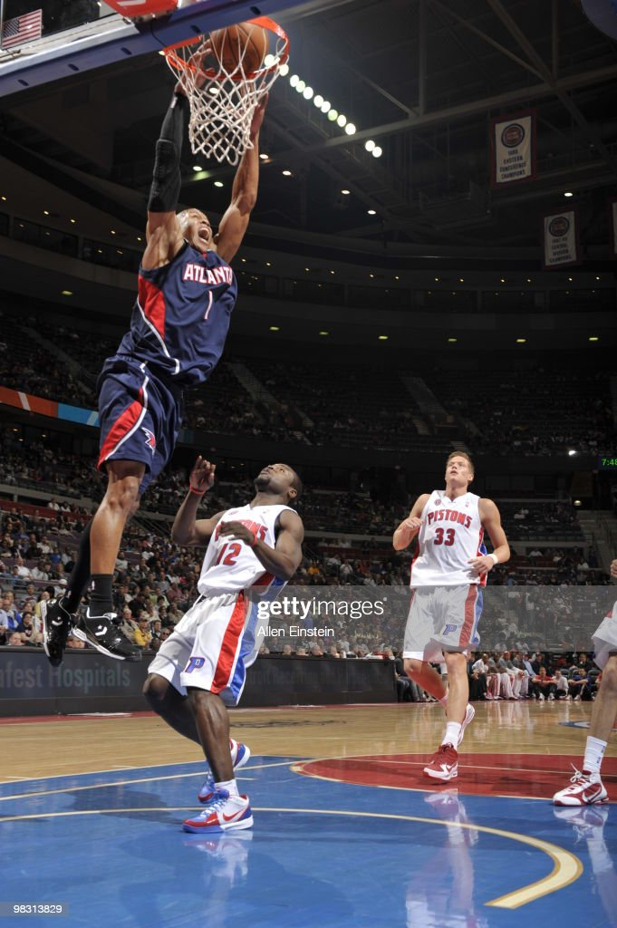 Maurice Evans of the Atlanta Hawks goes up for a dunk past Will Bynum of the Detroit Pistons in a game at the Palace of Auburn Hills on April 7 2010...