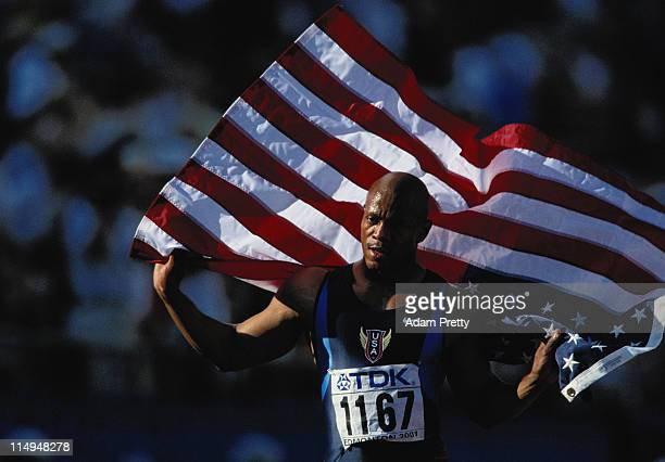 Maurice Greene of the United States waves his countries flag in celebration of his victory in the Men's 100 metre finals at the 8th IAAF World...