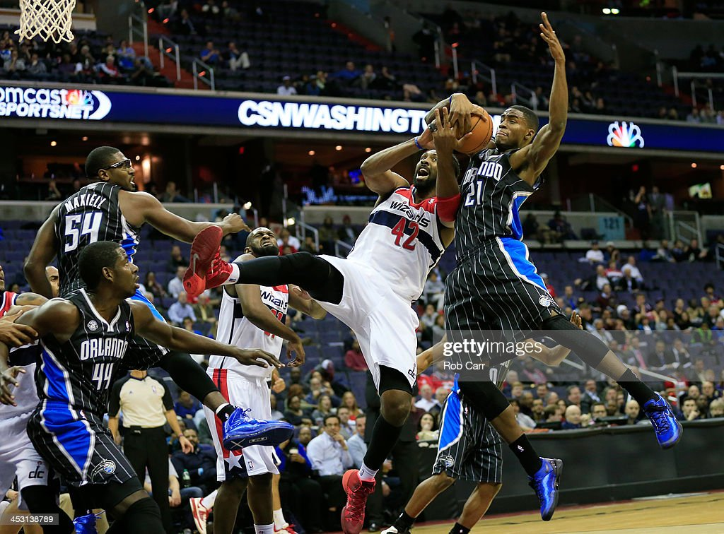 Maurice Harkless #21 of the Orlando Magic blocks a shot by Nene Hilario #42 of the Washington Wizards during the first half at Verizon Center on December 2, 2013 in Washington, DC.