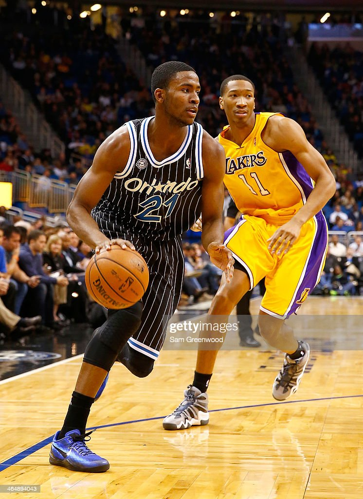 Maurice Harkless #21 of the Orlando Magic drives past <a gi-track='captionPersonalityLinkClicked' href=/galleries/search?phrase=Wesley+Johnson+-+Basketball+Player&family=editorial&specificpeople=4184049 ng-click='$event.stopPropagation()'>Wesley Johnson</a> #11 of the Los Angeles Lakers during the game at Amway Center on January 24, 2014 in Orlando, Florida.