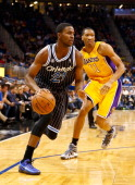 Maurice Harkless of the Orlando Magic drives past Wesley Johnson of the Los Angeles Lakers during the game at Amway Center on January 24 2014 in...