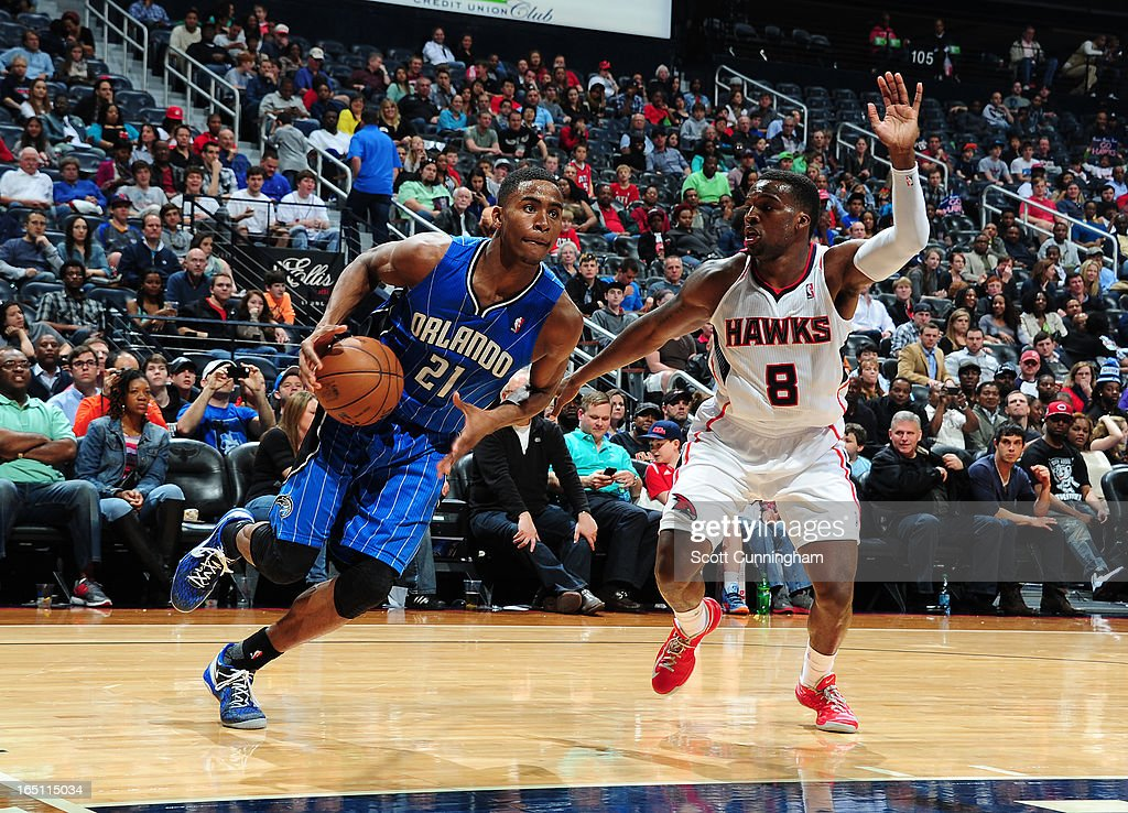 Maurice Harkless #21 of the Orlando Magic drives to the basket against Sheldon Mack #8 of the Atlanta Hawks on March 30, 2013 at Philips Arena in Atlanta, Georgia.
