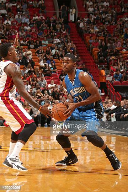Maurice Harkless of the Orlando Magic drives to the basket against Mario Chalmers of the Miami Heat at the American Airlines Arena in Miami Florida...