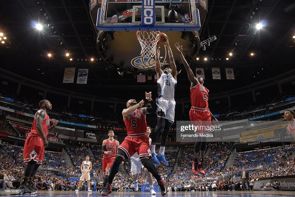 Maurice Harkless #21 of the Orlando Magic dunks against Carlos Boozer #5 and Luol Deng #9 of the Chicago Bulls on April 15, 2013 at Amway Center in Orlando, Florida.