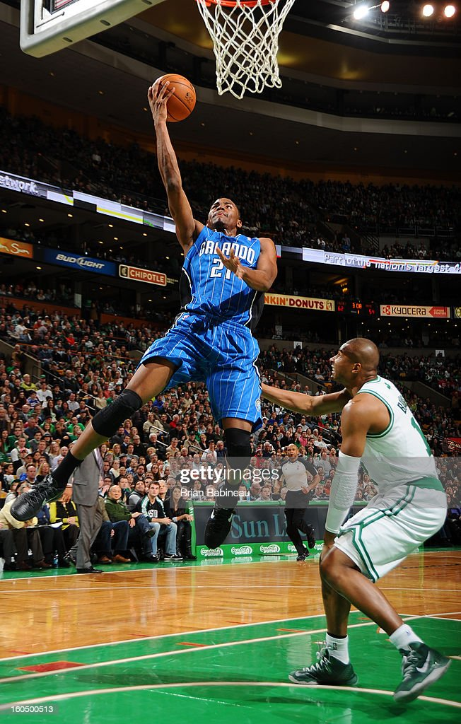 Maurice Harkless #21 of the Orlando Magic goes to the basket against <a gi-track='captionPersonalityLinkClicked' href=/galleries/search?phrase=Leandro+Barbosa&family=editorial&specificpeople=201506 ng-click='$event.stopPropagation()'>Leandro Barbosa</a> #12 of the Boston Celtics on February 1, 2013 at the TD Garden in Boston, Massachusetts.