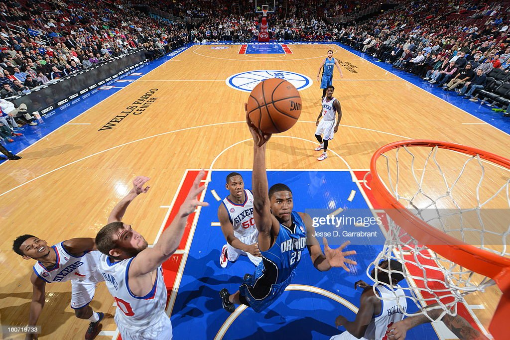 Maurice Harkless #21 of the Orlando Magic goes to the basket against <a gi-track='captionPersonalityLinkClicked' href=/galleries/search?phrase=Spencer+Hawes&family=editorial&specificpeople=3848319 ng-click='$event.stopPropagation()'>Spencer Hawes</a> #00 of the Philadelphia 76ers at the Wells Fargo Center on February 4, 2013 in Philadelphia, Pennsylvania.