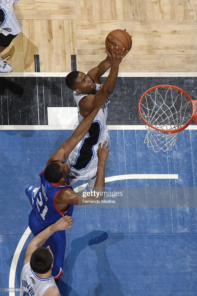 Maurice Harkless #21 of the Orlando Magic goes to the basket against Thaddeus Young #21 of the Philadelphia 76ers on March 10, 2013 at Amway Center in Orlando, Florida.