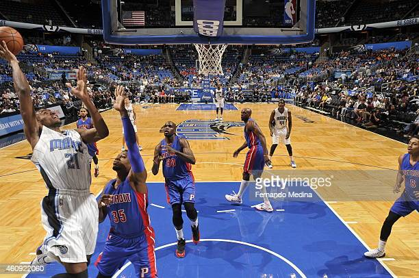 Maurice Harkless of the Orlando Magic goes to the basket against Cartier Martin of the Detroit Pistons on December 30 2014 at Amway Center in Orlando...