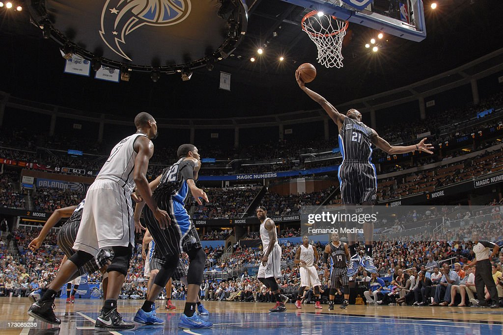 Maurice Harkless #21 of the Orlando Magic grabs a rebound against the Miami Heat on March 25, 2013 at Amway Center in Orlando, Florida.
