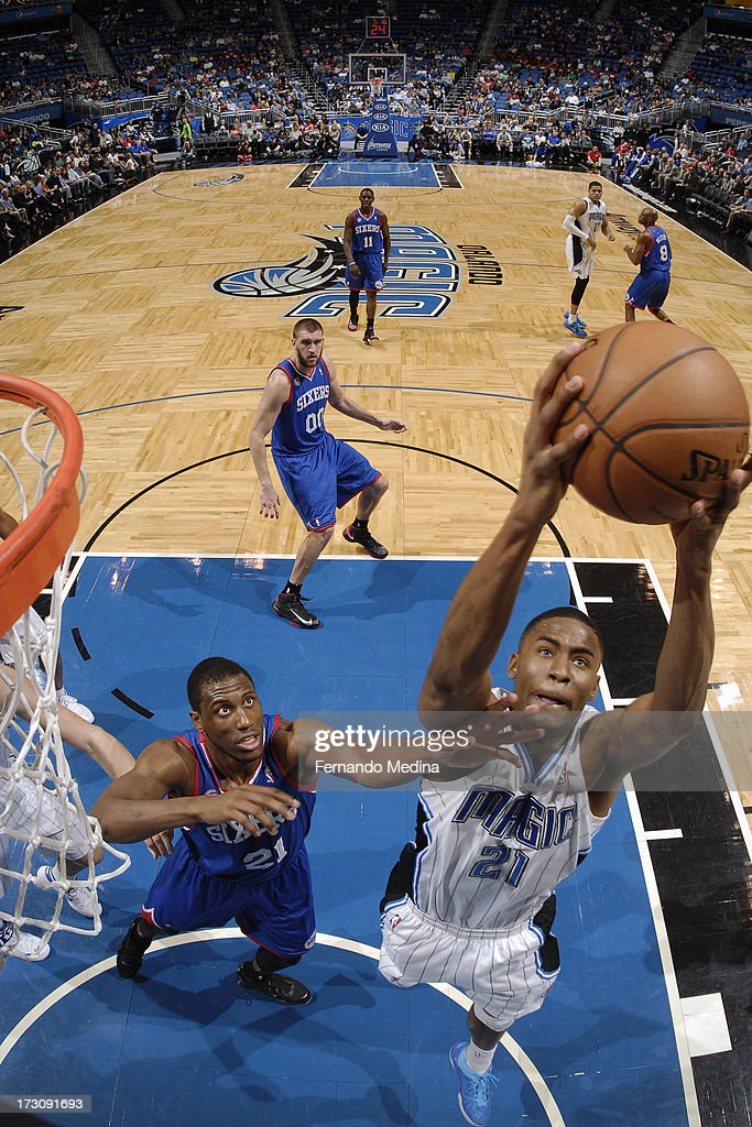 Maurice Harkless #21 of the Orlando Magic grabs a rebound against <a gi-track='captionPersonalityLinkClicked' href=/galleries/search?phrase=Thaddeus+Young&family=editorial&specificpeople=3847270 ng-click='$event.stopPropagation()'>Thaddeus Young</a> #21 of the Philadelphia 76ers on March 10, 2013 at Amway Center in Orlando, Florida.