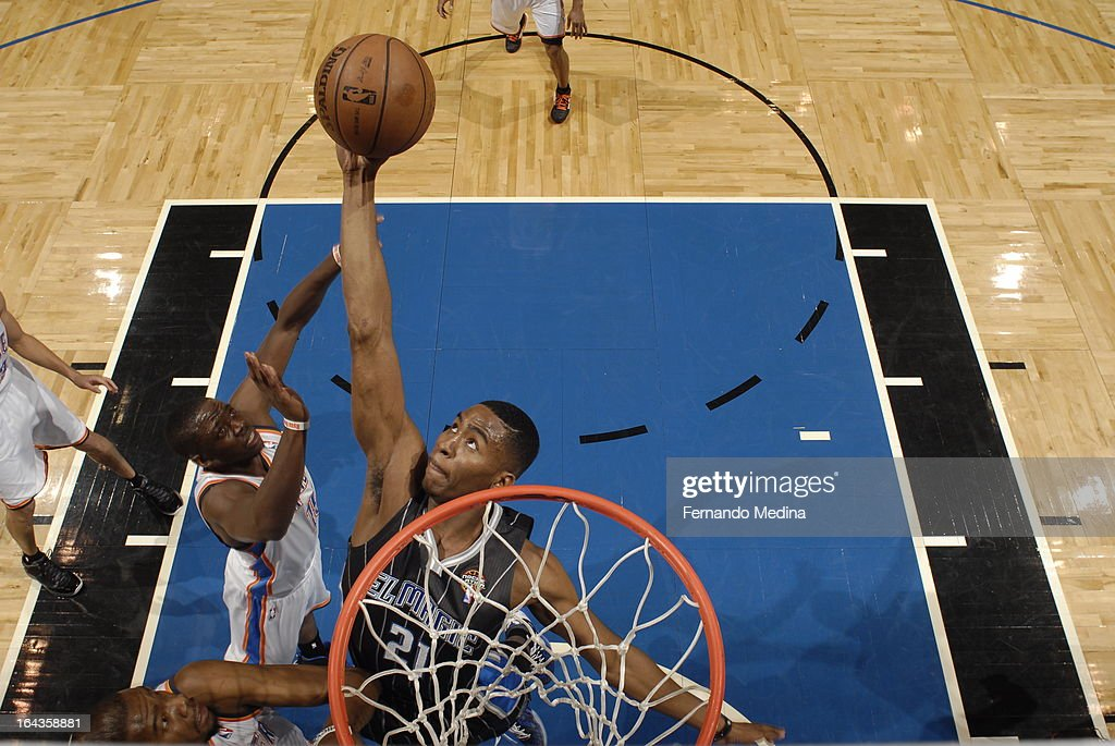Maurice Harkless #21 of the Orlando Magic grabs the ball in mid-air for the put back against the Oklahoma City Thunder during the game on March 22, 2013 at Amway Center in Orlando, Florida.