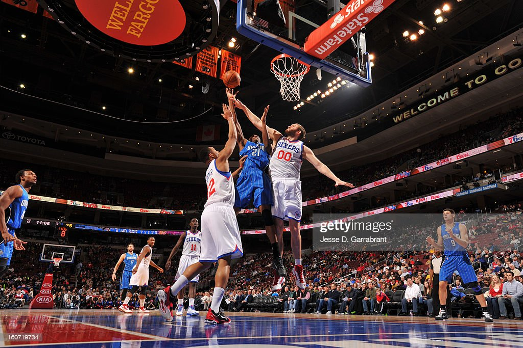 Maurice Harkless #21 of the Orlando Magic shoots against <a gi-track='captionPersonalityLinkClicked' href=/galleries/search?phrase=Spencer+Hawes&family=editorial&specificpeople=3848319 ng-click='$event.stopPropagation()'>Spencer Hawes</a> #00 and <a gi-track='captionPersonalityLinkClicked' href=/galleries/search?phrase=Evan+Turner&family=editorial&specificpeople=4665764 ng-click='$event.stopPropagation()'>Evan Turner</a> #12 of the Philadelphia 76ers at the Wells Fargo Center on February 4, 2013 in Philadelphia, Pennsylvania.