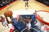 Maurice Harkless of the Orlando Magic shoots the ball against the Washington Wizards during the game at the Verizon Center on February 25 2014 in...