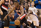 Maurice Harkless of the Portland Trail Blazers and Dion Waiters of the Oklahoma City Thunder chase the ball during the second period a NBA game at...