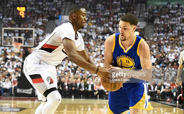 Maurice Harkless of the Portland Trail Blazers defends Klay Thompson of the Golden State Warriors during the first quarter of Game Four of the...