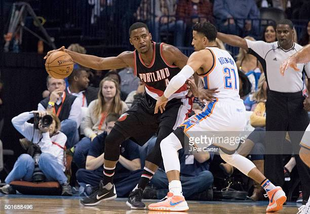 Maurice Harkless of the Portland Trail Blazers drives around Andre Roberson of the Oklahoma City Thunderduring the second period a NBA game at the...