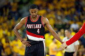 Maurice Harkless of the Portland Trail Blazers walks back to the bench during a time out of their game against the Golden State Warriors during Game...