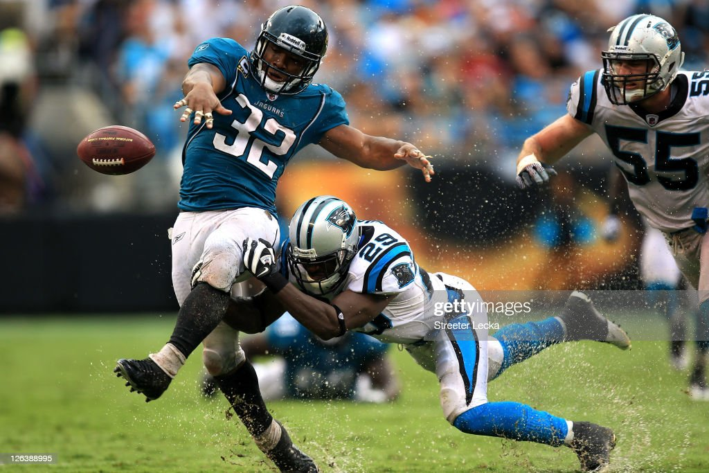 <a gi-track='captionPersonalityLinkClicked' href=/galleries/search?phrase=Maurice+Jones-Drew&family=editorial&specificpeople=243147 ng-click='$event.stopPropagation()'>Maurice Jones-Drew</a> #32 of the Jacksonville Jaguars fumbles the ball as he is hit by Jordan Pugh #29 of the Carolina Panthers during their game at Bank of America Stadium on September 25, 2011 in Charlotte, North Carolina.