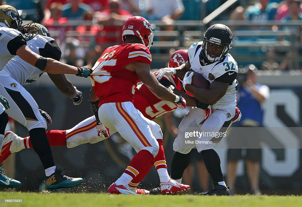<a gi-track='captionPersonalityLinkClicked' href=/galleries/search?phrase=Maurice+Jones-Drew&family=editorial&specificpeople=243147 ng-click='$event.stopPropagation()'>Maurice Jones-Drew</a> #32 of the Jacksonville Jaguars is tackled by <a gi-track='captionPersonalityLinkClicked' href=/galleries/search?phrase=Derrick+Johnson+-+American+Football+Player&family=editorial&specificpeople=226781 ng-click='$event.stopPropagation()'>Derrick Johnson</a> #56 of the Kansas City Chiefs during a game at EverBank Field on September 8, 2013 in Jacksonville, Florida.