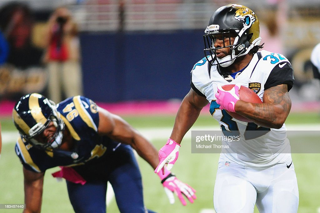 <a gi-track='captionPersonalityLinkClicked' href=/galleries/search?phrase=Maurice+Jones-Drew&family=editorial&specificpeople=243147 ng-click='$event.stopPropagation()'>Maurice Jones-Drew</a> #32 of the Jacksonville Jaguars rushes in a game against the St. Louis Rams at the Edward Jones Dome on October 6, 2013 in St. Louis, Missouri.