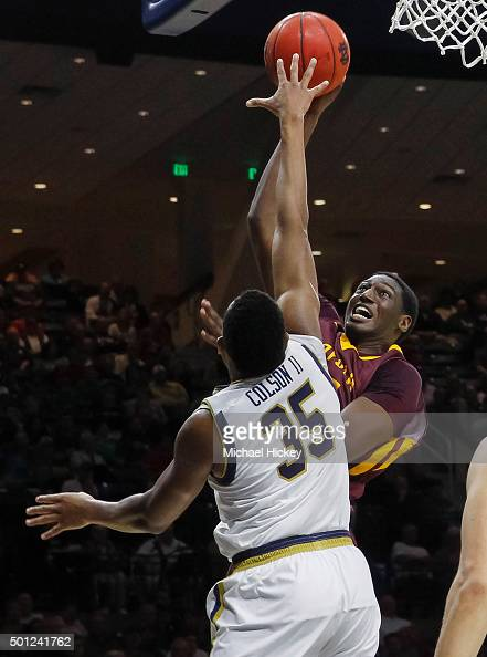 Maurice Kirby of the Loyola Ramblers shoots the ball against Bonzie Colson of the Notre Dame Fighting Irish at Purcell Pavilion on December 13 2015...