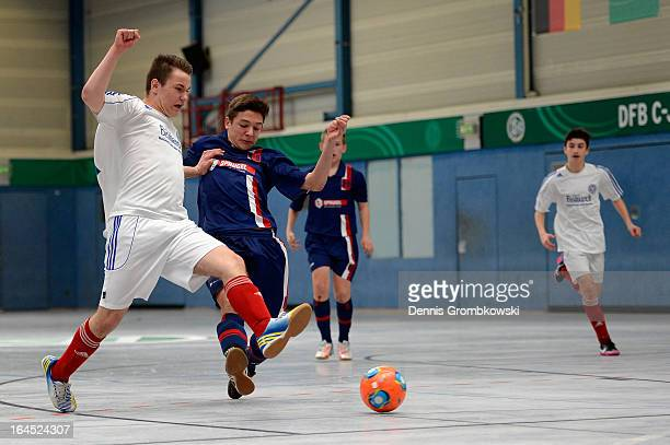 Maurice Knutzen of Holstein Kiel and Julian Popp of Hollenbach battle for the ball during the DFB C Juniors Futsal Cup final between KSV Holstein...
