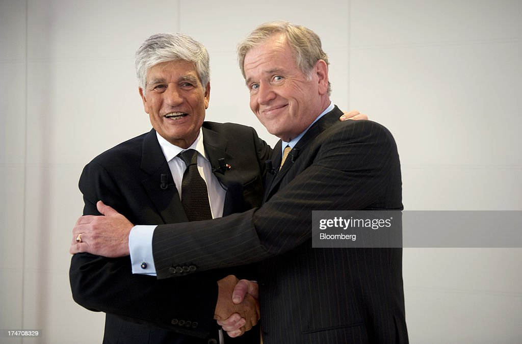 Maurice Levy, chief executive officer of Publicis Groupe SA, left, and John Wren, chief executive officer of Omnicom Group Inc., react following the merger of the two companies during a news conference at the Publicis headquarters in Paris, France, on Sunday, July 28, 2013. Publicis Groupe SA and Omnicom Group Inc. agreed to merge in an all-stock transaction to create the world's largest advertising company with $23 billion in revenue, toppling market leader WPP Plc. Photographer: Balint Porneczi/Bloomberg via Getty Images