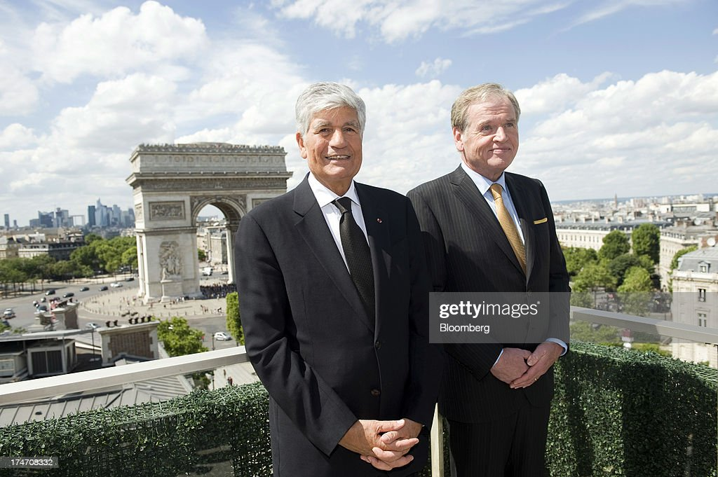 <a gi-track='captionPersonalityLinkClicked' href=/galleries/search?phrase=Maurice+Levy&family=editorial&specificpeople=588854 ng-click='$event.stopPropagation()'>Maurice Levy</a>, chief executive officer of Publicis Groupe SA, left, and John Wren, chief executive officer of Omnicom Group Inc., pose for a photograph after signing the merger during a news conference held on the rooftop of the Publicis headquarters in Paris, France, on Sunday, July 28, 2013. Publicis Groupe SA and Omnicom Group Inc. agreed to merge in an all-stock transaction to create the world's largest advertising company with $23 billion in revenue, toppling market leader WPP Plc. Photographer: Balint Porneczi/Bloomberg via Getty Images