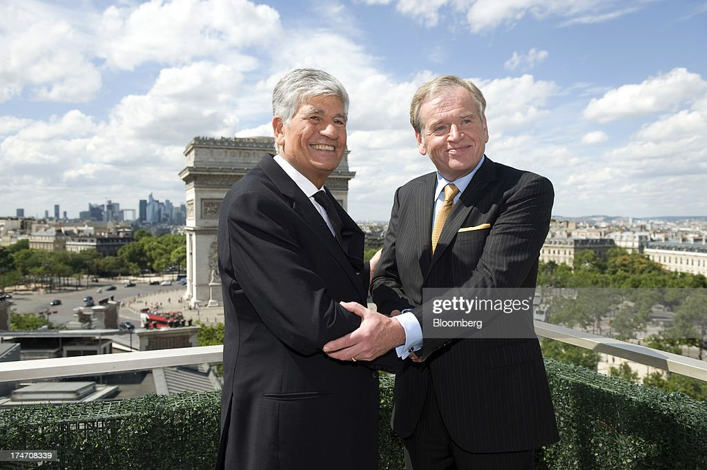 <a gi-track='captionPersonalityLinkClicked' href=/galleries/search?phrase=Maurice+Levy&family=editorial&specificpeople=588854 ng-click='$event.stopPropagation()'>Maurice Levy</a>, chief executive officer of Publicis Groupe SA, left, and John Wren, chief executive officer of Omnicom Group Inc., shake hands after signing the merger during a news conference held on the rooftop of the Publicis headquarters in Paris, France, on Sunday, July 28, 2013. Publicis Groupe SA and Omnicom Group Inc. agreed to merge in an all-stock transaction to create the world's largest advertising company with $23 billion in revenue, toppling market leader WPP Plc. Photographer: Balint Porneczi/Bloomberg via Getty Images