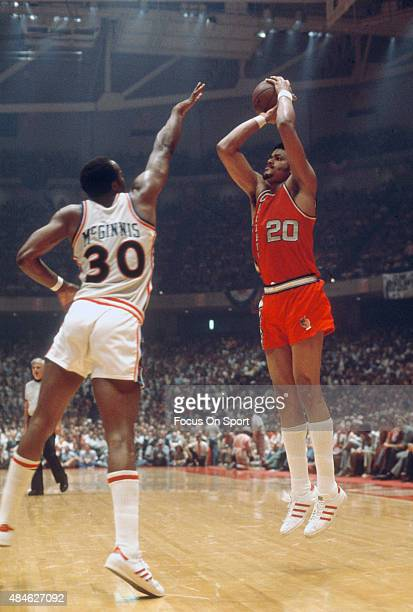 Maurice Lucas of the Portland Trail Blazers shoots over George McGinnis of the Philadelphia 76ers during an NBA basketball game circa 1977 at The...