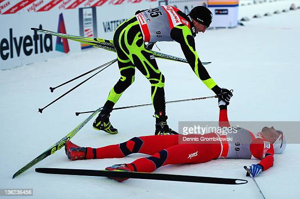 Maurice Manificat of France congratulates Petter Northug Jr of Norway during the FIS Tour de Ski Oberhof Men's Prolouge at DKB Ski Arena on December...