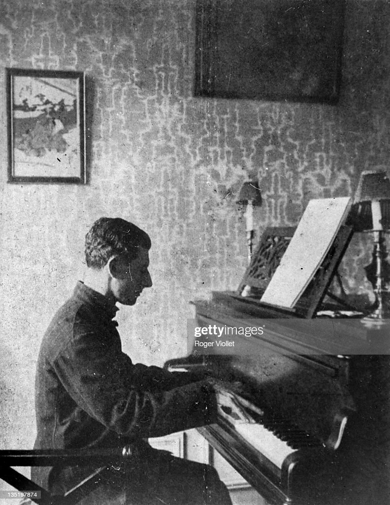<a gi-track='captionPersonalityLinkClicked' href=/galleries/search?phrase=Maurice+Ravel&family=editorial&specificpeople=488980 ng-click='$event.stopPropagation()'>Maurice Ravel</a> (1875-1937), French composer, playing the piano in France, January 1913.
