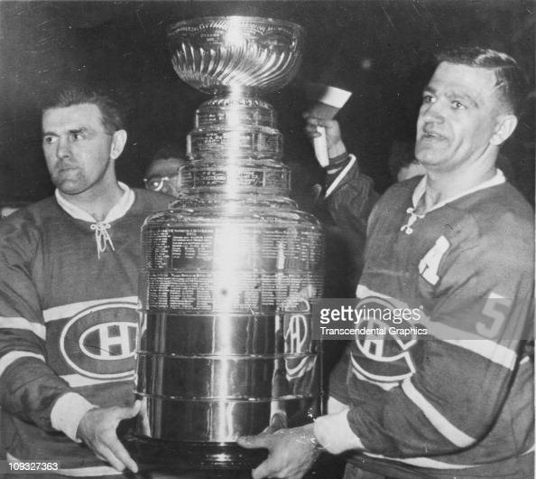Maurice Richard and Bernie Geoffrion of the Montreal Canadiens hold the Stanley Cup Trophy after defeating the Boston Bruins in Game 6 of the 1958...