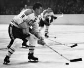 Maurice 'Rocket' Richard of the Montreal Canadiens skates with the puck during a game circa 19561960 at the Montreal Forum in Montreal Quebec Canada