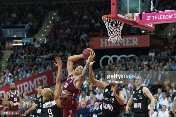 Maurice Stuckey of Wuerzburg Maik Zirbes of Bayern Muenchen Ryan Anderson of Wuerzburg and Vytenis Lipkevicius of Wuerzburg battle for the ball...