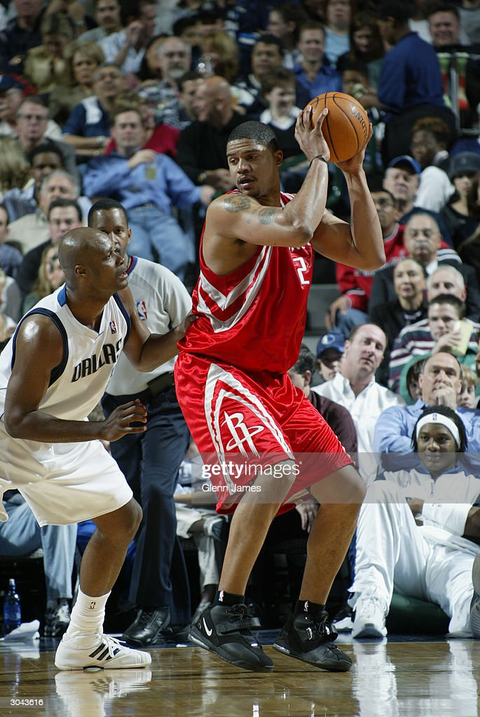 Maurice Taylor #2 of the Houston Rockets posts up Antoine Walker #8 of the Dallas Mavericks during the game at the American Airlines Arena on February 21, 2004 in Dallas, Texas. The Mavericks won 97-88.