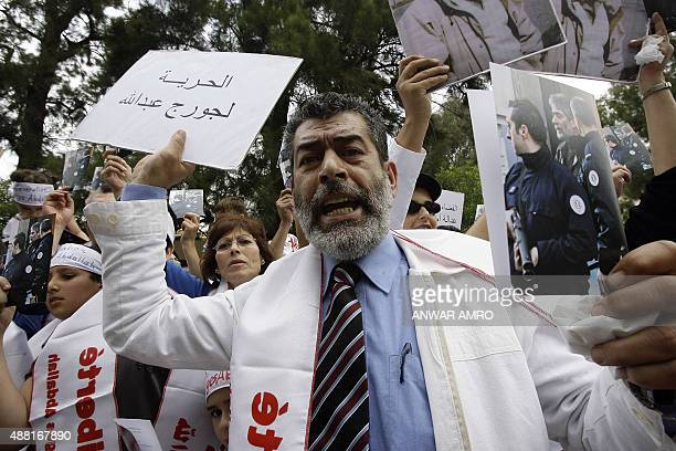 Maurice the brother of Georges Ibrahim Abdallah takes part in a demonstration outside the French embassy in Beirut on April 30 2010 to call on France...