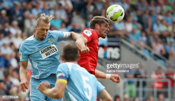 Maurice Trapp of Chemnitz challenges Ronny Koenig of Zwickau during the 3Liga match between Chemnitzer FC and FSV Zwickau at community4you Arena on...